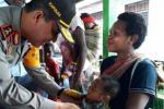 Polda Papua Gelar Baksos Pengobatan Massal di Asmat